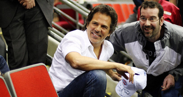 Tom Gores and fan at a Pistons game